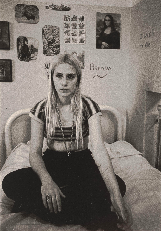 Brenda Sitting on Her Bed